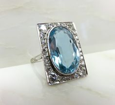 Circa 1930 6.12 Carat Aquamarine and Diamond Ring Set in Platinum by camelliacollection on Etsy https://www.etsy.com/listing/194416906/circa-1930-612-carat-aquamarine-and