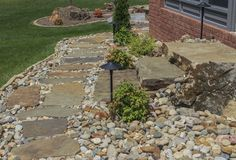 Beautiful outdoor living project! Love the natural stone walkway and steps!