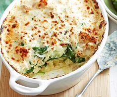 Potato, spinach and tuna bake recipe - By Woman's Day, With golden parmesan and a zesty tuna sauce this hearty bake will warm your family on cold winter nights. Tuna Recipes, Salmon Recipes, Potato Recipes, Seafood Recipes, Vegetarian Recipes, Healthy Recipes, Lasagna Recipes, Pasta Recipes, Chicken Recipes