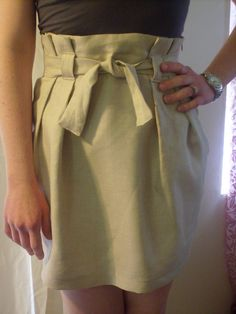 I mentioned in my twisted hem tutorial that I could put up instructions on how to make a paper bag waist skirt, if you were interested.  The...