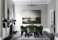 brendan wong // pale gray dining room with chic black accessories & green velvet covered chairs