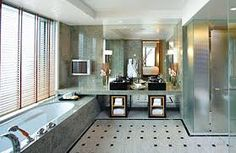 bath against end wall, vanity/storage, shower in middle, toilet against laundry wall.