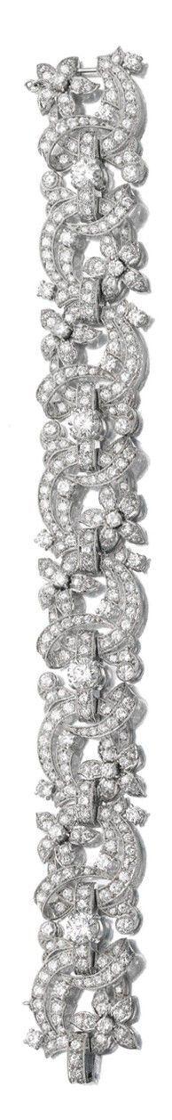 A DIAMOND BRACELET of floral design, millegrain-set with circular-cut diamonds, length approximately 190mm.