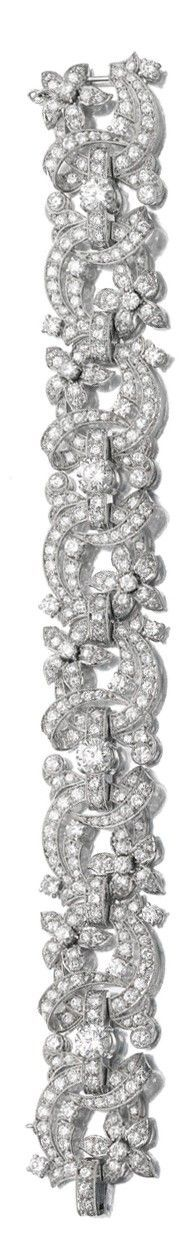 A DIAMOND BRACELET of floral design, millegrain-set with circular-cut diamonds, length approximately 190mm.