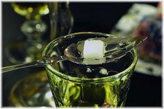 """In Prague's bars, the drink is served by burning a small amount of Absinthe-soaked sugar on a spoon, which you then stir into your glass of Absinthe and douse with water (1-2 parts water to Absinthe). It is worth noting that the Czech spelling of absinthe is """"absinth,"""" leaving off the """"e""""."""