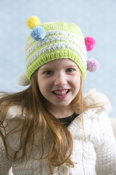 Rainbow Gumdrops Hat - Have a blast making this wacky design for your son, daughter, or grandchild. Made with colorful pom poms, this hat will add a dose of whimsy to your child's wardrobe. From the December 2014 issue of I Like Knitting