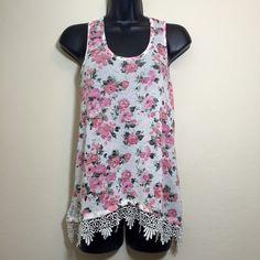 Floral and lace printed knit top Unsure of size of brand because tag was removed. Fits like a size small. Material is stretchy. No flaws. Feels like good quality material. Very cute!! Tops Tank Tops