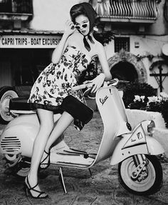 Vintage glam on Capri in Italy would not be complete without a vespa. I am guessing it's a faded pink.