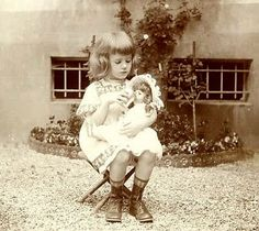 Little girl and her baby doll