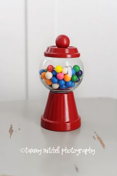 Mini Gumball machines made of a small terra cotta pot and base, a small round votive holder and red spray paint