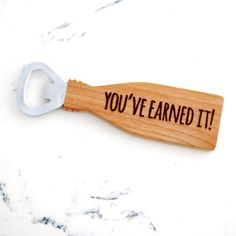 "Maple bottle Opener, ""You've Earned It"". Engraved wood with magnet inside. Fathers Day gift idea for him under 20."