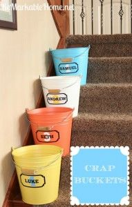 Name label buckets for when picking up each childs random items around house an place then let the child put up there own items in room