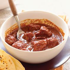 Carne Adovada (Red Chile and Pork Stew) by Sunset Magazine. Pure ground dried red chiles are the star of Carne Adovada, a simple stew filled with tender chunks of boneless pork shoulder. Mexican Dishes, Mexican Food Recipes, Mexican Menu, Haitian Recipes, Carne Adovada, Pork Recipes, Cooking Recipes, Chilli Recipes, Boneless Pork Shoulder