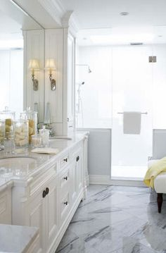 bathrooms - white bathroom cabinets mirror chrome sconces marble countertops marble tiles floors shower crown molding master bathroom  Gorgeous