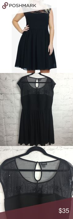 Torrid Embroidered Mesh Illusion Keyhole dress 22 A sheer mesh yoke with embroidered flowers and sequin accents lends a delicate texture to this sleeveless chiffon LBD. A keyhole adds a sexy detail. Gorgeous and in Excellent Condition. Size 22. torrid Dresses