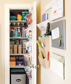 Clear the counter clutter.  Organize with wall-mountable solutions. Consider blackboard by phone/calendar.  Extend cabinet end with curved shelf or slots to hold note pads/pens.  Over door shoe bags can be trimmed down to fit cabinet doors and hold small items together.