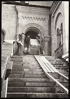 Photograph shows four men carrying a crate of recovered artworks, previously looted by the Nazis during World War II, down a staircase at Neuschwanstein Castle.   Citation: Recovery of looted artworks, 1945 / unidentified photographer. James J. Rorimer papers, Archives of American Art, Smithsonian Inst...
