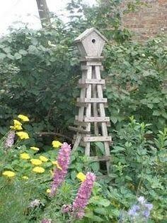 Garden bird house on obelisk