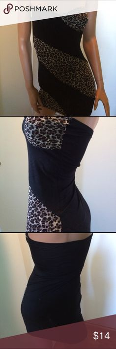 """NWOT dress You will be the top cat in this sexy, strapless, leopard print dress!!🐾🐆...stretchy & clingy & oh so nice...24"""" top of bust to bottom...13"""" armpit width...94% rayon/6% spandex...Never Worn Misope Dresses Strapless"""