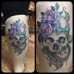 Skull with roses and lace tattoo.