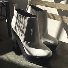 "Kendall and Kylie Platform boots White Kendall and Kylie Madden Girl platform bootie! Elastic gore insets provide the perfect fit on a trendy platform bootie set on a chunky block heel. 5"" heel; 1 3/4"" platform  1 1/4"" boot shaft. Synthetic upper, lining and sole. Madden Girl Shoes Platforms"