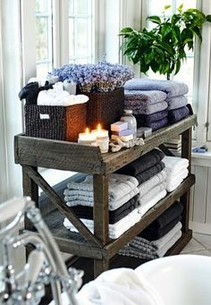 What a beautiful way to store towels in a bathroom!
