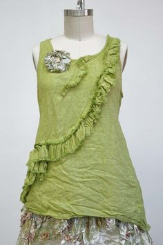 Features:   	Charming tank top  	Ruffle detail across entire tank  	Slight asymmetrical hem  	100% Linen, Key Lime  	Fits sizes 2-14  Pictured with: Petticoat Cami & Ooh La La Skirt
