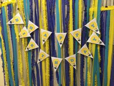 Happy birthday garland with blue and yellow backdrop