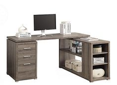 This Cliver L-desk will be a stunning focal point in your contemporary home office. This simple and stylish piece features thick panels and clean lines in a dark taupe, reclaimed wood-look finish. The writing desk offers a spacious work surface that is great for doing paperwork or for using with a computer. The secondary surface offers an additional workspace and extra shelves that can be used for a printer or other important items. This piece also features 2 medium storage drawers and a…