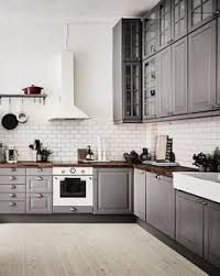 Image result for grey kitchen cabinets with white subway tiles and butcher block counter