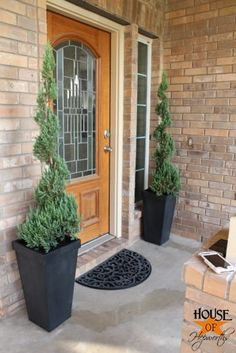 front porch.  Tall planters, trees.