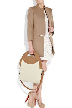 Fold Over Canvas & Faux Leather Bag by Stella McCartney - This classy bag has a detachable shoulder strap and a design detail that can transform into a handle. See more at http://designandkindness.blogspot.com/2011/06/kindness-is-in-bag.html