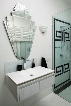 Gatsby Inspired Interior: Black and white greek key tile pattern with art deco inspired mirror