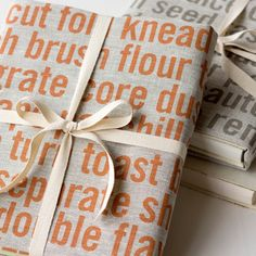 Tea Towel Present. Love, love, love this idea. Would be great with a cookbook and maybe some wooden spoons affixed with ribbon.