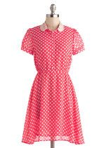 Supper Powers Dress in Coral Pink with polka dots.