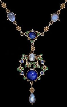 A delicate Arts and Crafts gold necklace, by Jessie M King for Liberty & Co. The pendant set with cabochon sapphires and mother-of -pearl within a border of green enamelled leaves and small sapphires with a moonstone drop. The enamelled chain set with sapphires and moonstones. British. Circa 1900.