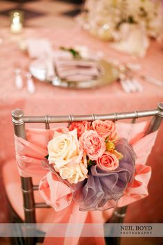 Receptions chairs.  Pink flowers & pink ribbons.  Pink colored wedding recpetions with grey details.