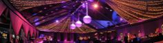 purple lit tent with string lights