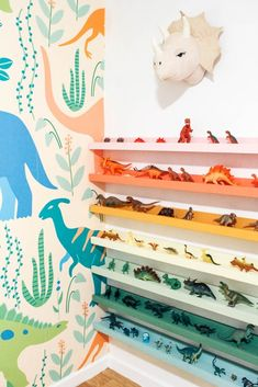 Do you have a kid's room and need some toy storage ideas? I made rainbow dino ledges for my boy's bedroom. Childen's books would also work on these shelves. Click through for the full tutorial. Dinosaur Kids Room, Boys Dinosaur Bedroom, Dinosaur Room Decor, Dinosaur Nursery, Dinosaur Toys, Dinosaur Bedding, Kids Bedroom Boys, Boy Toddler Bedroom, Childs Bedroom