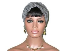 Silver Turban, Handmade Metallic by Couture Service LIMITED EDITION!Soft, cowhide leather fused to a soft rayon backing.Front twist, top-stitched hem, completely hand gathered back with reinforcing, finished seams, finished edges.Medium fits 22 1/2 inch head. (57.15 cm)Mannequin's head is 22 inches.Meticulously hand made.