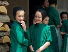 Amish girls gather outside the school house prior to the start of their final day of class in Bergholz, Ohio, April 9, 2013.
