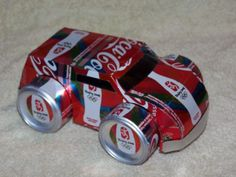 Tesscar Aluminum Craft -- Recycle your favorite beverage can into a work of art! When I was traveling in Thailand, I bought a Tuk Tuk made out of Coke cans. Recycling, Recycle Cans, Upcycle, Reuse, Aluminum Can Crafts, Metal Crafts, Coke Can Crafts, Pop Can Art, Art Pop