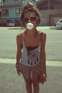 Camera's ready? Sunglasses, bubblegum, topknot, nail polish and cute summer outfit. A must do!
