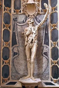 """From Morbid Anatomy by Ligier Richier in 1547. This fantastic figure, displayed in the Saint-Étienne church in the city Bar-le-Duc in France, once held the heart of its subject-- René de Chalon, Prince of Orange--in its raised hand, like a reliquary. The prince died at age 25 in battle following which, depending on which story you believe, either he or his widow requested that Chalon portray him in his tomb figure as """"not a standard figure but a life-size skeleton with strips of dried sk..."""
