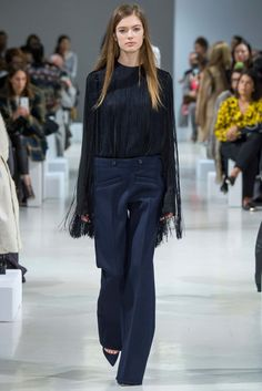 Nina Ricci | Fall 2015 Ready-to-Wear | 07 Black fringed long sleeve top and blue trousers