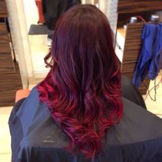 Scarlet balayage ombre hairstyle for dark hair color, with natural waves