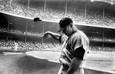 <b>1965</b> | In one of the most eloquent photographs ever made of a great athlete in decline, Yankee star Mickey Mantle flings his batting helmet away in disgust after another terrible at-bat near the end of his storied, injury-plagued career. Originally published in the July 30, 1965, issue of LIFE.