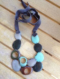 Constructed with 100% natural materials, this tagua necklace is handmade by Ecuadorian artisans
