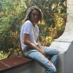 Rosie Huntington-Whiteley, at home in Los Angeles, wears an artfully thrashed skinny with the flirty reveal of ticking-stripe pocket linings.  Paige Denim Jimmy Jimmy Skinny in Sawyer Destructed, $239 paige.com