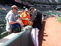 Jason Hammel signs an autograph for some Orioles fans.